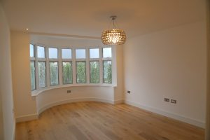 Curved window feature with BetweenGlassBlinds installed