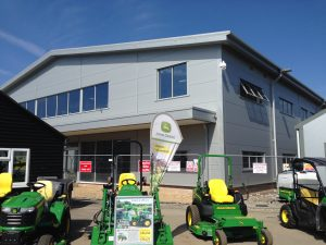 Outside of commercial building with John Deere tractors